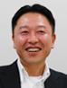 写真: システム本部 インフラ開発部 次長 (インフラ開発グループ担当) 須崎 謙祐氏