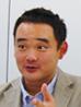 写真: システム本部 インフラ開発部 インフラ開発グループ 副主事 (システムPM) 藤田 雄吾氏