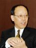 写真 (左): 総務部長 山仲 嘉則氏
