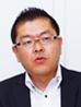 写真: リビング新聞グループ 管理局 情報システム部 部長 高野 浩明
