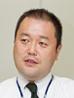 写真: システム推進部 システム推進課長 塙 博行氏