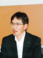 写真: KDDI株式会社 理事 総務部・人事本部 総務部長 土橋 明