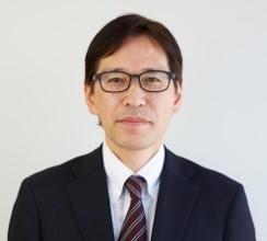 写真: KDDI株式会社 CSR・環境担当役員 総務・人事本部長 土橋 明